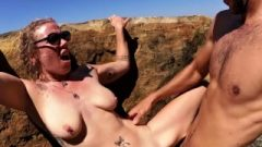 Fair-haired With Sweet Natural Breasts Smashed Against A Rock